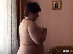 Granny with big tits displays her body